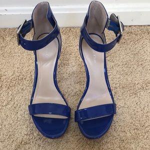 Calvin Klein 7M blue Vivian platform sandals .